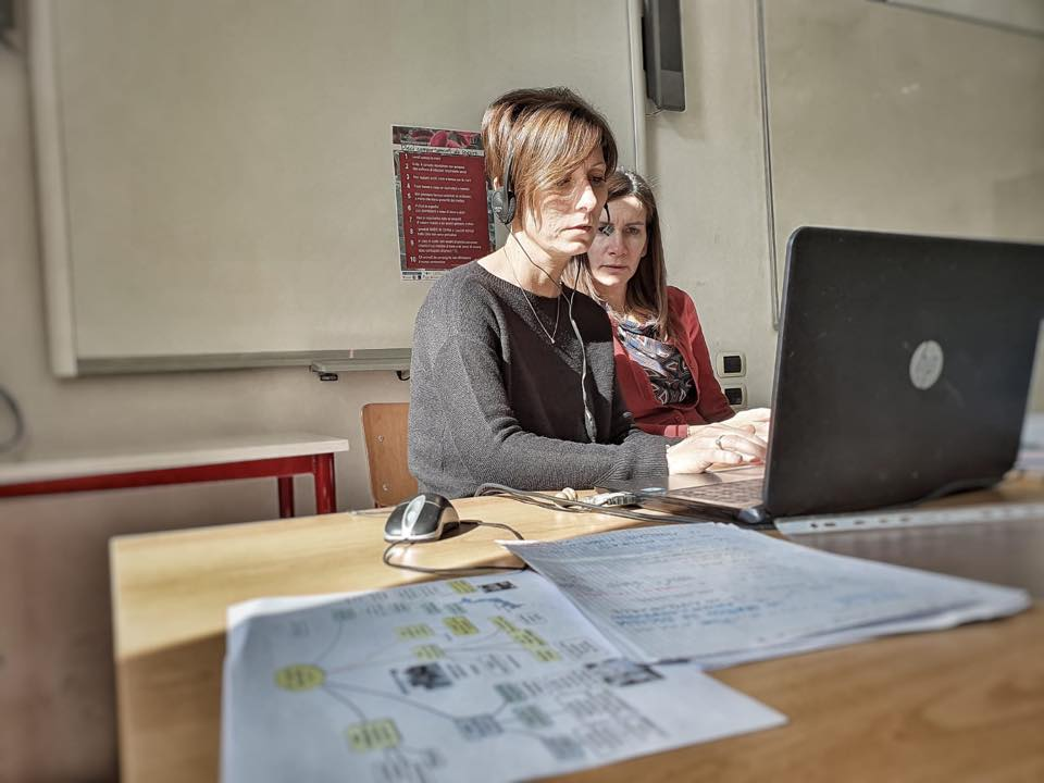 Two women working at laptop