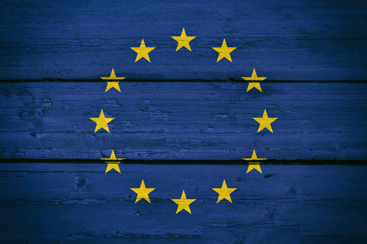 EU stars on background of blue-painted wooden boards